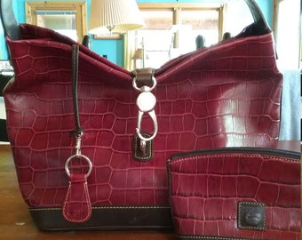 Gorgeous Downey Bourne wine colored handbag made in Italy