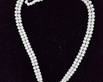 Handbeaded necklace with nickel pendant