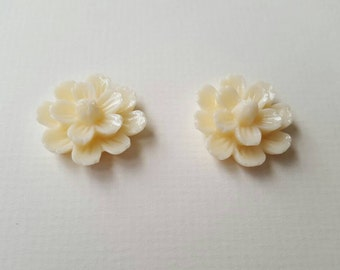 2 large cream/white cabochon flowers