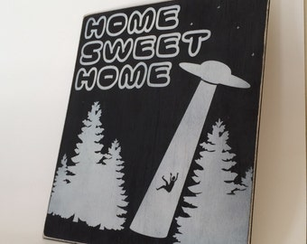 Home sweet home ufo alien sign for home display, college dorm or apartment. Far out alien abduction sign.