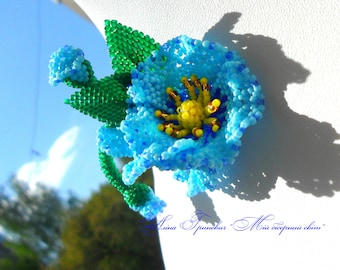 It's a little blue brooch from small, high-quality Japanese beads.