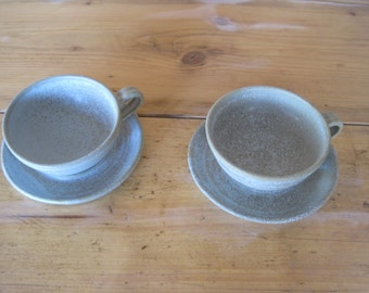 Pair of hand made stoneware cups and  saucers