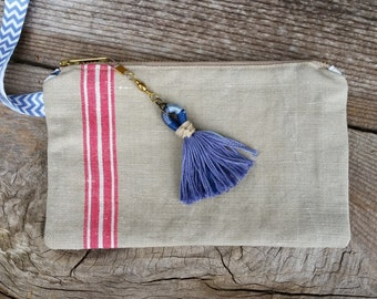 Ecru and red stripe vintage French linen zippered pouch, floral print lining, elastic wrist strap and handmade tassel