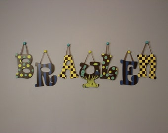 Customized hand painted letters for nursery or child's room.