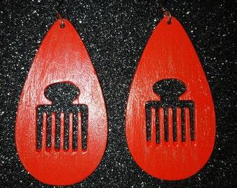 Afro pick earrings.
