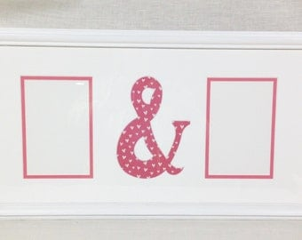 "Picture frame witha custom mat for two pictures and an""&"" symbol"