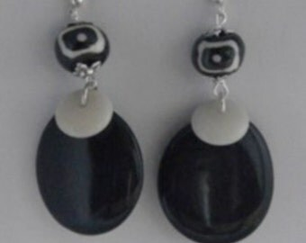 Large black blade of tagua and small white disk earrings