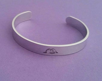 Beautiful Angel baby cuff bangle hand stamped with an angel baby design miscarriage rememberance baby loss