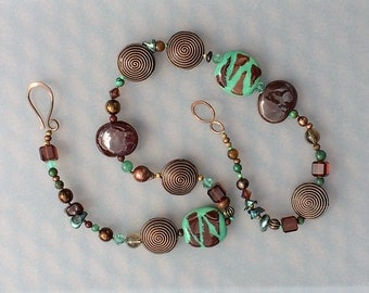 Kazuri necklace with pearls, crystals; stone, glass and copper beads; teal