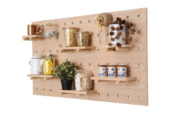Peg wall pegboard feature wall wall decor open shelving for Kitchen cabinets lowes with nursery decor wall art