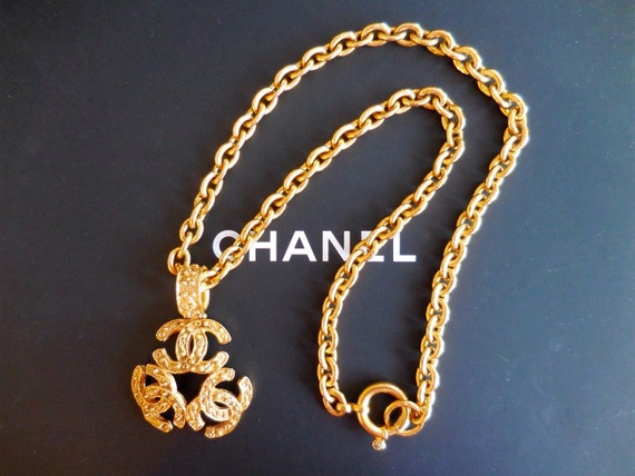 Year 1994 authentic vintage Chanel long chain statement necklace with a large triple CC logo pendant, beautiful patterns