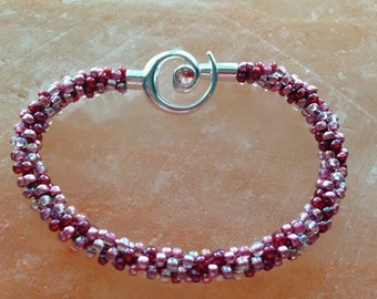 Rosy beaded Kumihimo bracelet