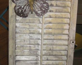 beautiful distressed look decorative shutter