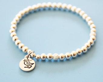Sterling beaded bracelet, sterling silver beaded bracelet with charm,beaded stretch bracelet,bird charm bracelet,stamped bird charm,stardust