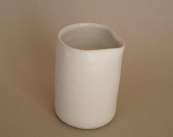 White stoneware pourer