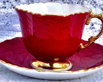 Stunning Aynsley Red and Gold Raised Relief Pedestal Teacup and Saucer