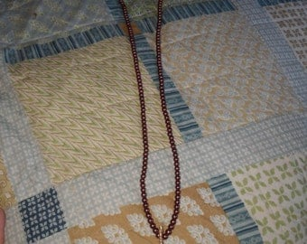 hand strung long beaded necklace with stone pendant