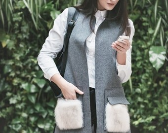 Wool vest with fur pockets