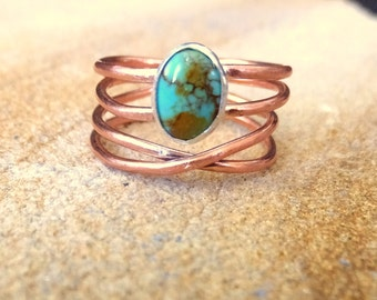 Antique turquoise stone in copper wire setting