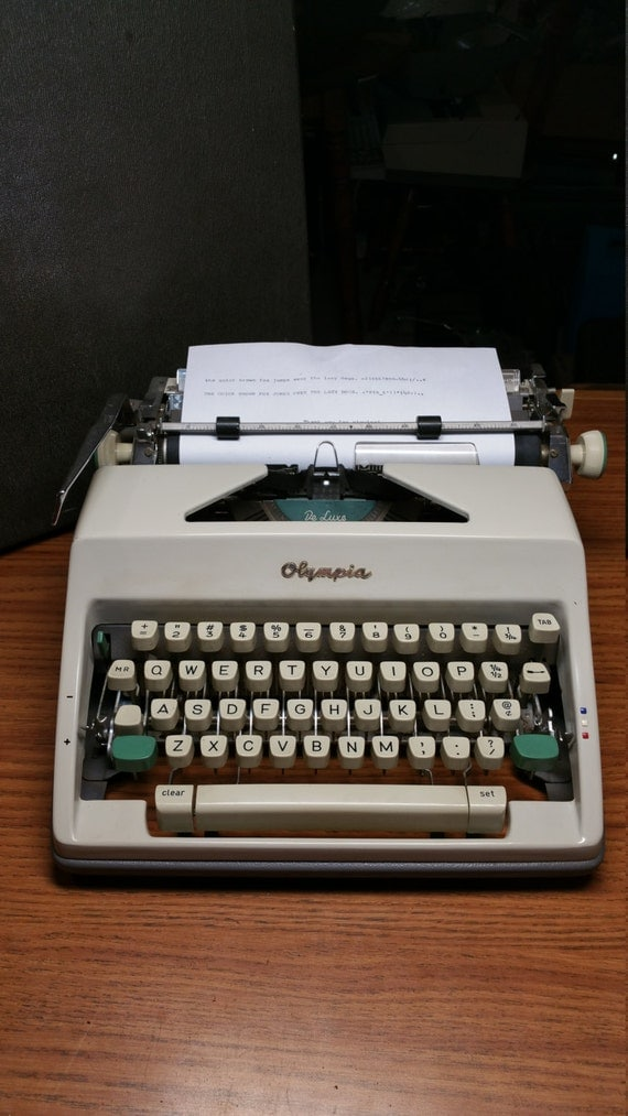 1966 Olympia SM9 portable typewriter with case - works great!