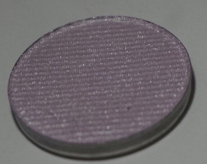 Lotus - whiteish pink base with green shift pressed highlighter