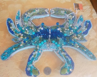 Blue jewel crab adorned with vintage jewelry