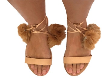 Women's leather gladiator sandals with pompoms