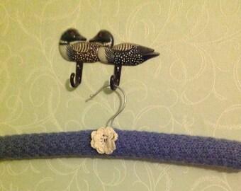 Padded knitted coat hanger
