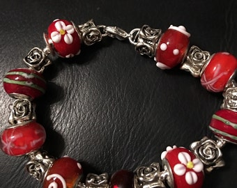Sterling Silver Bracelet with red and white  glass beads and silver spacers.