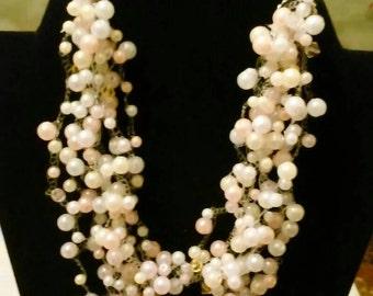 Pearl illusion necklace with swarovski crystals.