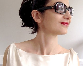 Authentic Chanel sunglasses. Very chic Audrey Hepburn style!