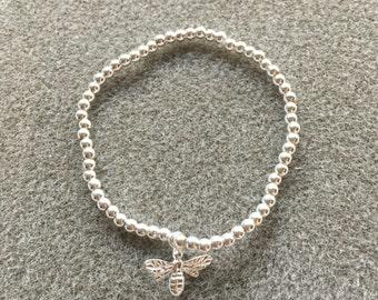 Sterling silver bee charm stretch ball bracelet
