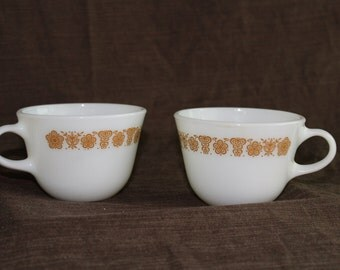 Two Pyrex Butterfly Gold tea cups