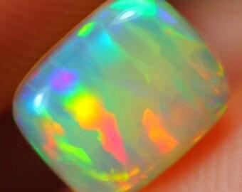 A GORGEOUS 0.82Ct Bright 5/5 Neon Ribbon Ethiopian Opal