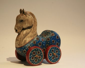 Horse with wheels, wooden horse on wheels