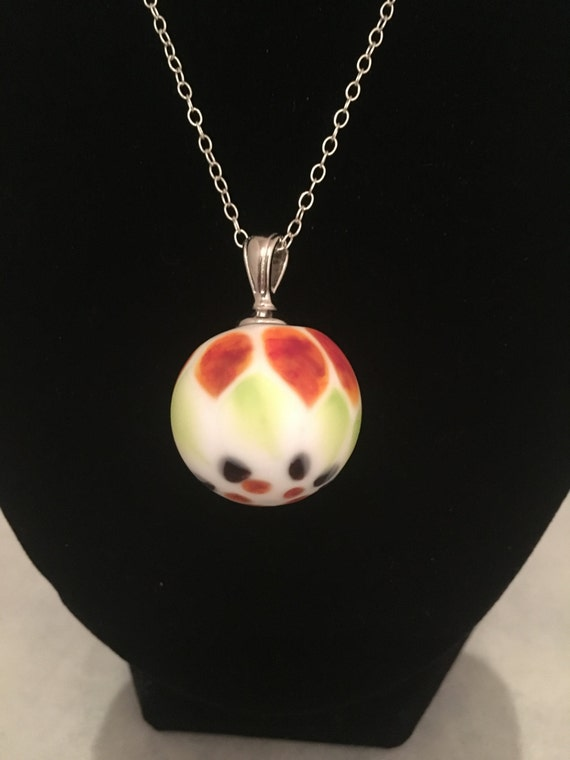 Venetian style blown glass bead strung on sterling silver