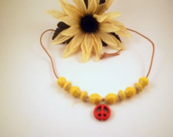 Chunky beads with peace sign on leather