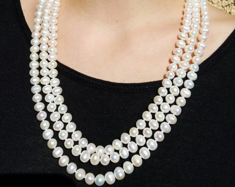 Freshwater Triple Strand White Pearl Necklace.