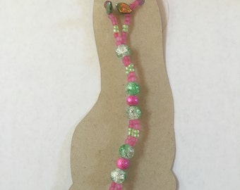 Pink and green beaded barefoot sandals