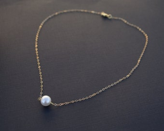 14k gold filled necklace with a prefect around freshwater pearls