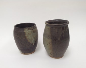 Small vases, matte grey and brown, with speckled designs
