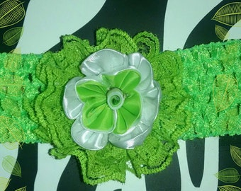 Neon green crocheted headband with neon green and white kanzashi flower