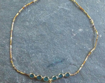 blue and gold glass beaded and 14k gold plated sun stretchy necklace