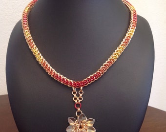 Fire-colored, enamelled, copper necklace in Persian-style chainmaille