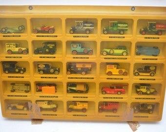 Two collectors cabinets containing a collection of 50 Matchbox models of Yesteryear