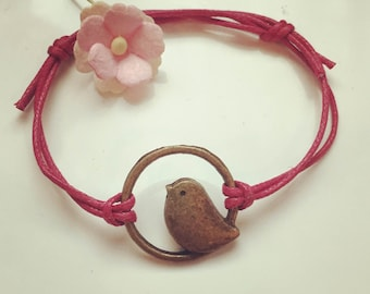 Bracelet made of waxed cotton in pink with a bird - pendant, vintage, statement, blogger, bird circle, bird