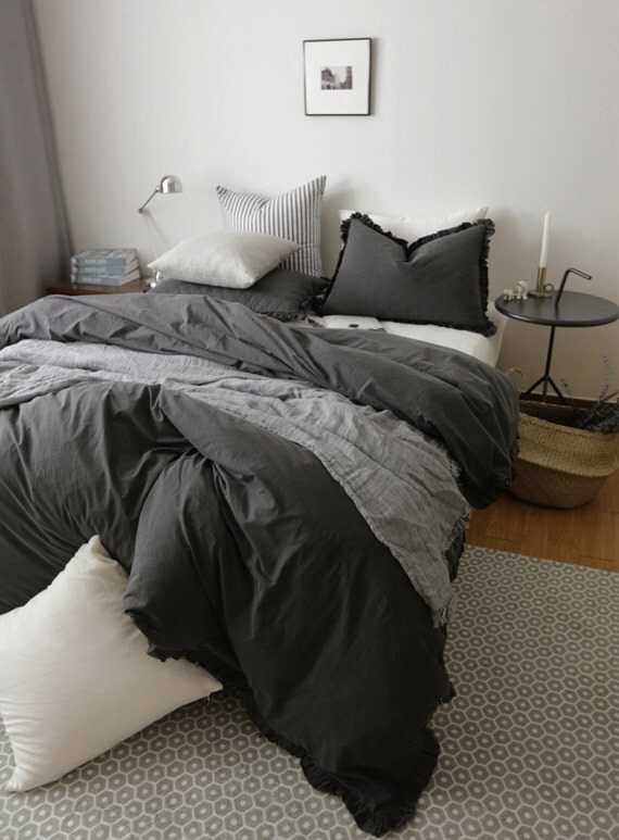 Stone washed black duvet cover set with ruffles by for Black and white marble bedding