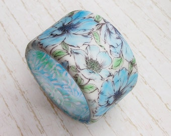 Pearly white bracelet in pale blue flowers bracelet pastel floral pattern romantic image white bracelet polymer clay light blue bracelet