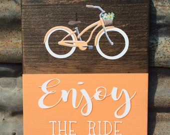 Enjoy the Ride bicycle in orange with flower basket