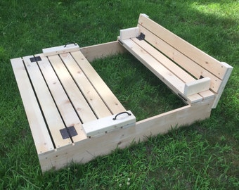 Sandbox with folding cover and built-in benches